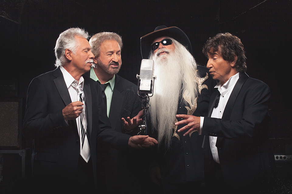 members of The Oak Ridge Boys singing into one microphone