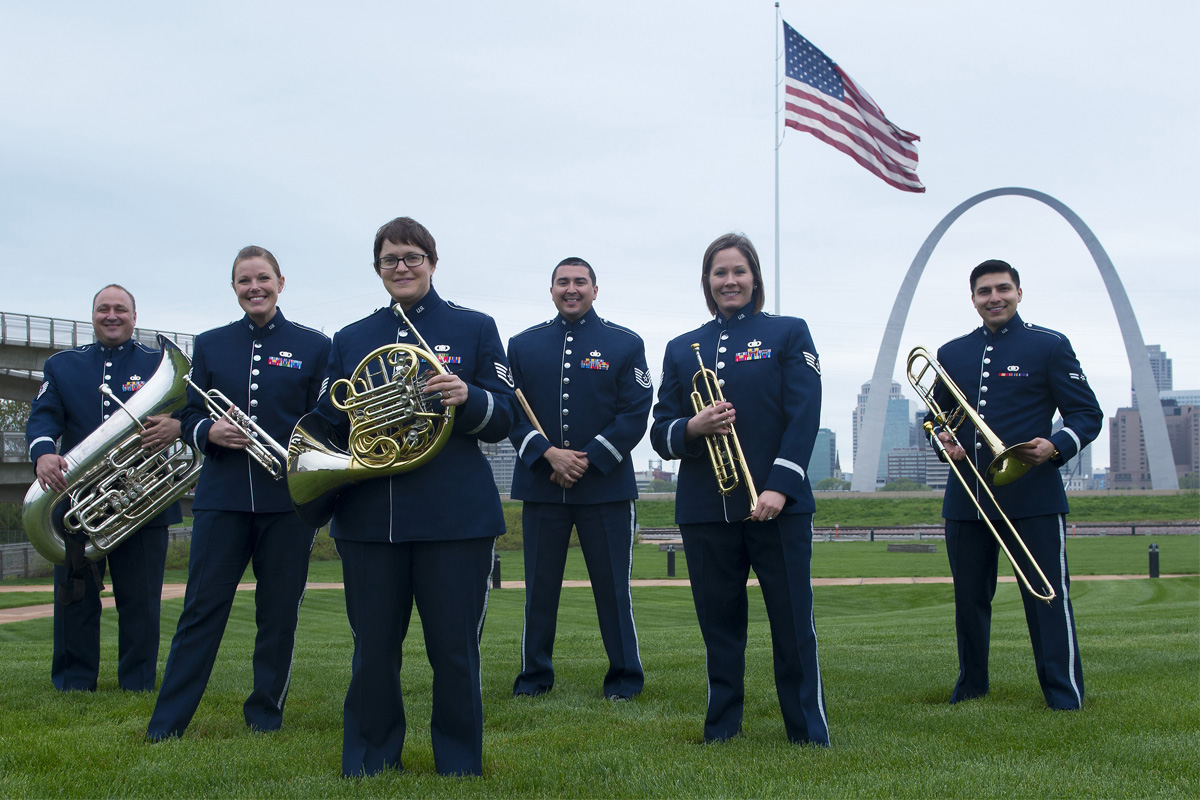 US Airlifter Brass Quintet standing by the St. Louis Arch